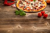 foto of hot fresh pizza  - Delicious italian pizza served on rustic wooden table