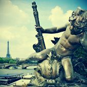 picture of Seine River and the Eiffel Tower in Paris, France, from Pont Alexandre III, with a retro effect