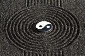 stock photo of yang  - Japanese ZEN garden with stone of yin and yang in raked sand - JPG