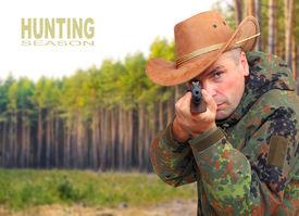 image of gunshot  - The hunter with hunting rifle aiming at you - JPG
