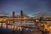 stock photo of water-mill  - Steel Bridge with Broadway and Fremont Bridges Over Willamette River at Evening Blue Hour in Portland Oregon - JPG