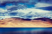 Vintage retro effect filtered hipster style travel image of Himalayan mountain lake in Himalayas Tso Moriri, Korzok,  Changthang area, Ladakh, Jammu and Kashmir, India
