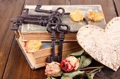 image of skeleton key  - Beautiful composition with old key and old books on wooden background - JPG