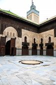Courtyard and minaret of bou inania madrasa
