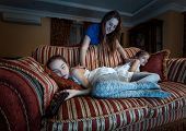 Mother Waking Up Two Daughter Fell Asleep At Night While Watching Tv