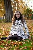 Beautiful Young Woman At Fall