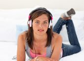 Beautiful Teenager Listening To The Music On His Bed