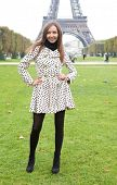 Beautiful Young Woman In Polka Dot Trench Near The Eiffel Tower