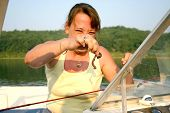 picture of night crawler  - Girl holding up worm she needs for fishing  - JPG
