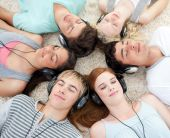 High Angle Of Teenagers Listening To Music