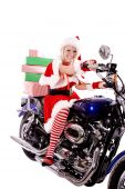 Santas Helper On Motorcycle With Stack Of Gifts