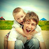 Happy Teenager And Kid