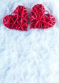 Two beautiful romantic vintage red hearts together on a white snow background. Love and St. Valentines Day concept. Space for your text.