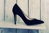 Black women shoes on wooden background