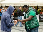 White Hoody Boy Gives A Cigarette To Black Guy