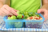 Woman making tasty vegetarian lunch, close up