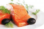 pink salmon bit on a big white dish