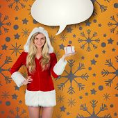 Pretty girl in santa outfit holding gift against yellow vignette