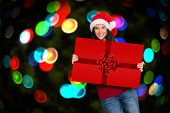 Woman holding a sign against red christmas ribbon
