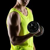 sport, bodybuilding, training and people concept - close up of young man with dumbbell flexing muscles over black background