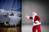 Santa pulls something with a rope against grey room