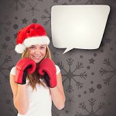Festive blonde with boxing gloves against grey vignette