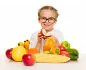 little girl with fruits and vegetables