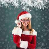 Sexy santa girl wearing spectacles against green vignette