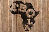 Black ebola text on africa outline against wooden surface with planks