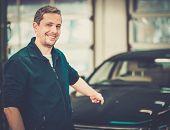 Cheerful man on a car wash