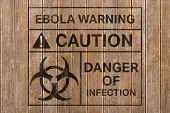 Ebola virus alert against wooden surface with planks