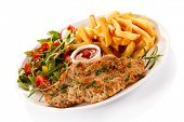 Pork chop, French fries and vegetables