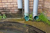 Modern Plastic Drain Pipe With Flowing Rain Water