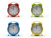 Four colorful alarm clocks isolated on white background 3D