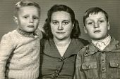 DARZLUBIE, POLAND, MARCH 24, 1953: Vintage photo of mother with sons