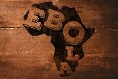 Black ebola text on africa outline against overhead of wooden planks