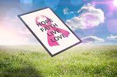 Breast cancer awareness message against sunny landscape