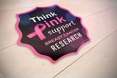 Breast cancer awareness message against bleached wooden planks background