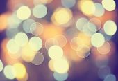Christmas lights defocused background. Vintage styled holiday abstract bokeh