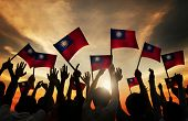 Group of People Waving Taiwanese Flags in Back Lit