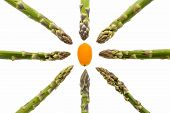 Eight Asparagus Spears Aiming At One Kumquat