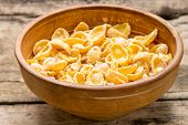 Clay Bowl With Dried Corn Flakes