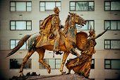 Street view with statue in Midtown Manhattan