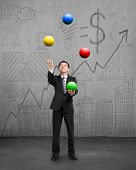 Standing Businessman Playing Colorful Balls
