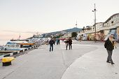 Tourists On Promenade In Yalta City In Evening