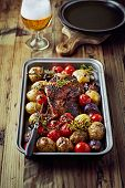 Roast pork with vegetables and herbs