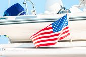 Small Flag States On The Background Of Yachts