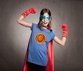 little girl wearing a superhero costume