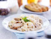 italian fettuccine alfredo pasta with grilled chicken dinner
