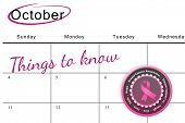 Breast cancer awareness message in pink against october on calendar